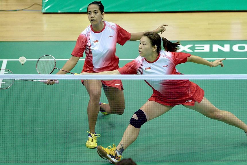 Singapore shuttlers Shinta Mulia Sari (left) and Yao Lei had to settle for bronze at the SEA Games after losing in the women's doubles semi-finals in Naypyidaw on Friday, Dec 13, 2013. -- ST PHOTO:LIM SIN THAI