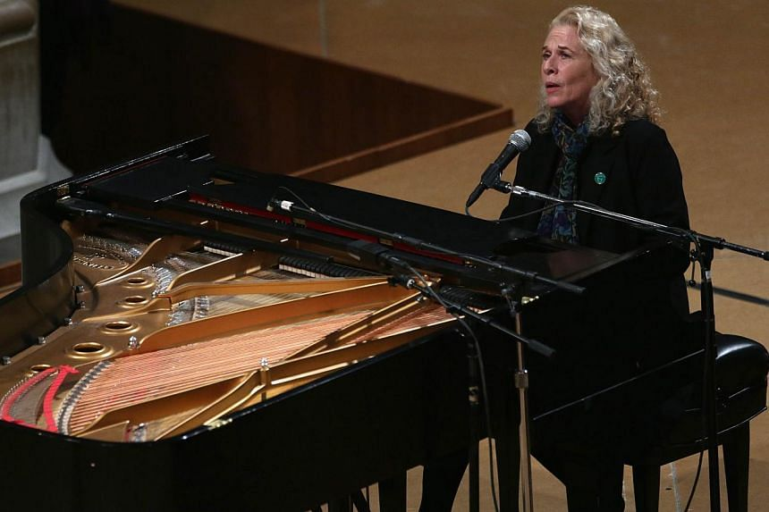 Singer-songwriter Carole King performs during the National Vigil for Victims of Gun Violence on Dec 12, 2013 at the Washington National Cathedral in Washington, DC. The event was to mark the first anniversary of the Dec 14, 2012 shooting that killed