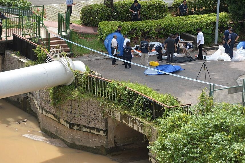 The decapitated body of a woman was recovered from Whampoa River after a jogger and a cleaner spotted part of it in the canal on the morning of Dec 12, 2013. Police on Friday classified the case as murder and investigations are ongoing. -- ST FILE PH
