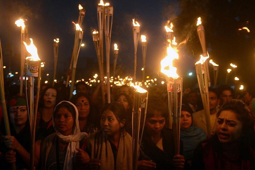 Bangladeshi activists march in the street with torches and shout slogans during a protest demanding the immediate execution of Bangladeshi war crimes convict Abdul Quader Molla, the 65-year-old senior leader of the Jamaat-e-Islami party in Dhaka, on