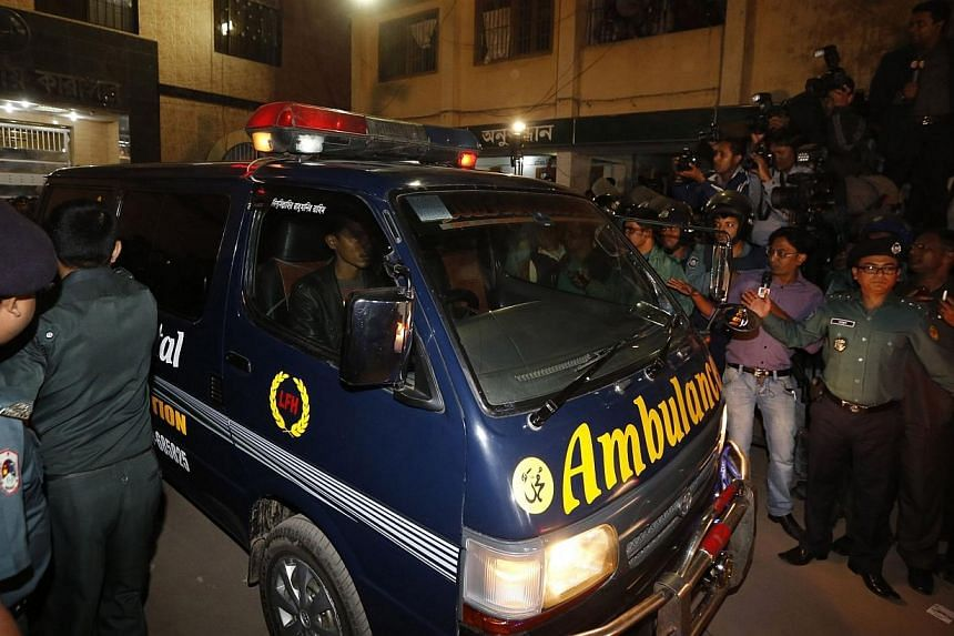 One of a convoy of three ambulances leave the central jail in Dhaka, on Dec 12, 2013. -- PHOTO: REUTERS