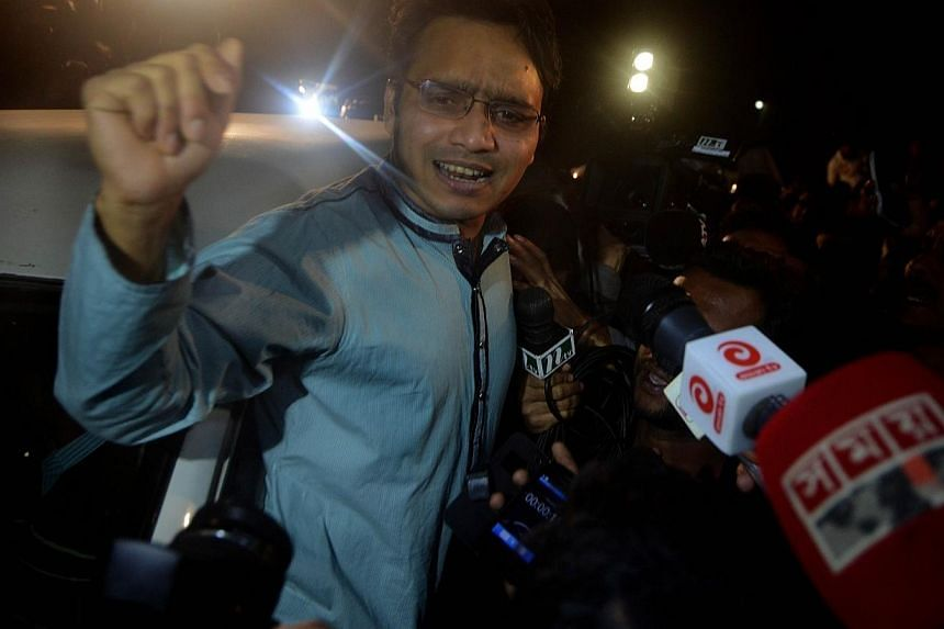 Hasan Jamil, son of Bangladesh war crimes convict Abdul Quader Molla, the 65-year-old senior leader of the Jamaat-e-Islami party, reacts while talking to the media after meeting with his father at a prison in Dhaka, on Dec 12, 2013. -- PHOTO: AFP