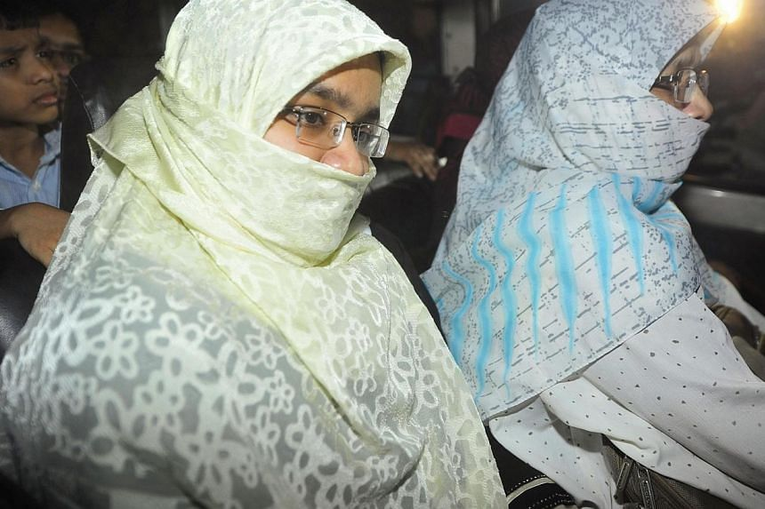 Relatives of Islamist leader Abdul Quader Mollah sit in a vehicle leaving Dhaka Central Jail after meeting with Mollah, in Dhaka, on Dec 12, 2013. -- PHOTO: REUTERS