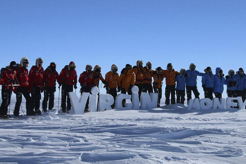 Teams pose for a picture on the first day of the Virgin Money South Pole Allied Challenge 2013 expedition in Antarctica December 1, 2013. Britain's Prince Harry and a team of injured troops from the United States, Canada and Australia were set to rea