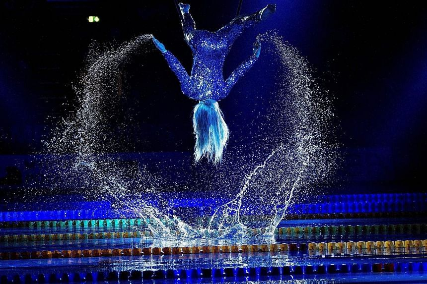 A woman performs at the opening ceremony of the Len European Short Course Swimming Championships in Herning, Denmark on Dec 12, 2013. See more pictures from around the world in Through The Lens' Today in Pictures. -- PHOTO: AFP