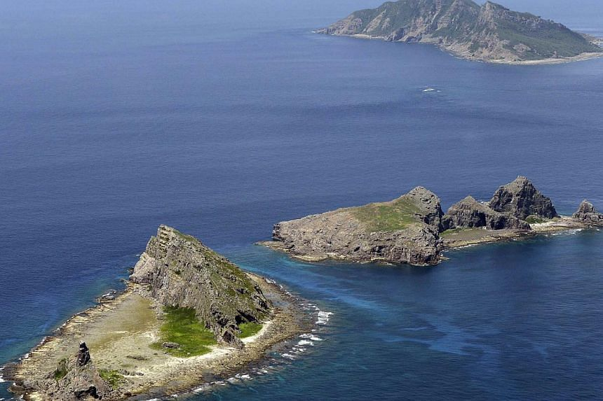 A group of disputed islands, Uotsuri island (top), Minamikojima (bottom) and Kitakojima, known as Senkaku in Japan and Diaoyu in China is seen in the East China Sea, in this photo taken by Kyodo in September 2012.Japan will pledge billions of d