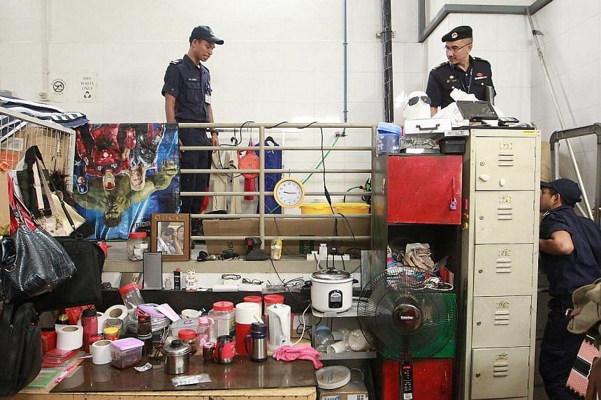Officers from the Singapore Civil Defence Force (SCDF) find change of space issues at the basement carpark of VivoCity during an enforcement blitz on fire safety.-- ST PHOTO:NEO XIAOBIN