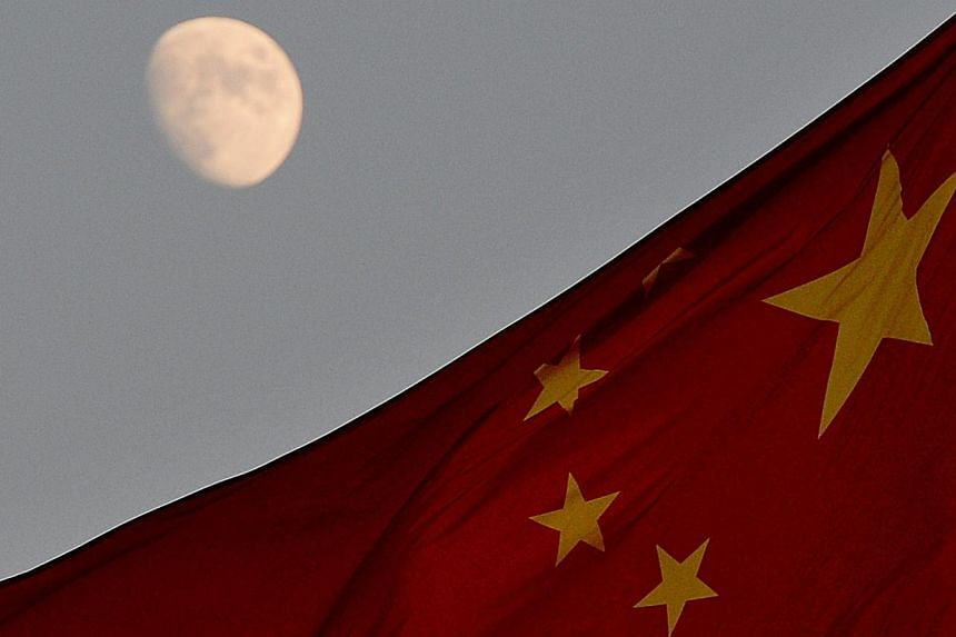 A space module carrying China's first lunar rover landed on the moon on Saturday, state television showed, the first soft landing on the moon in nearly four decades and a major step for the emerging superpower's ambitious space programme. -- PHOTO: A