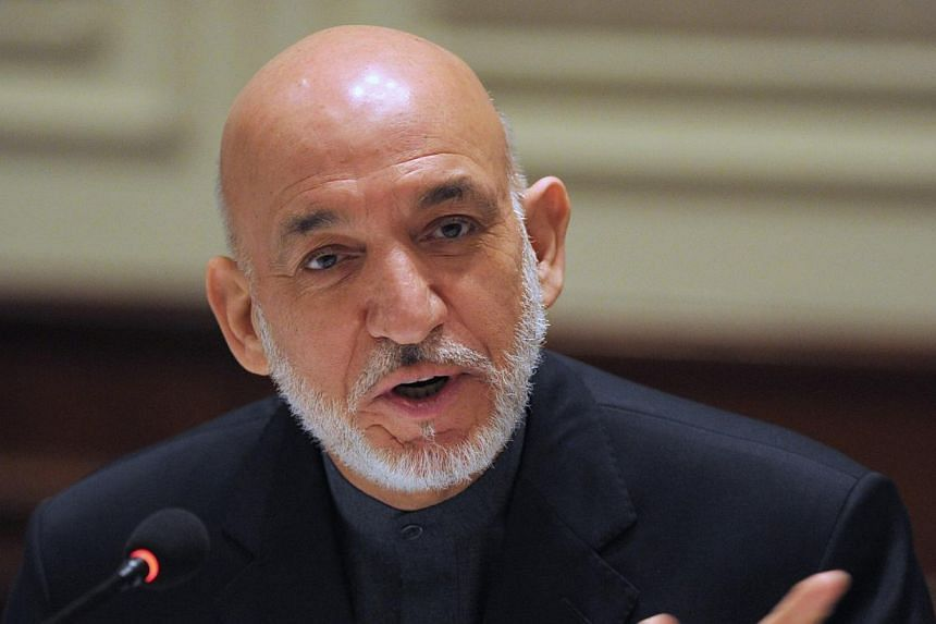 """Afghan President Hamid Karzaiaddresses media representatives during a press interaction in New Delhi, on Saturday, Dec 14, 2013.Mr Karzai said in New Delhi on Saturday he no longer """"trusts"""" the United States, accusing the Americans of say"""