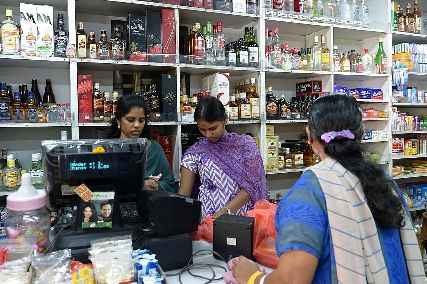 Patronage and sales of alcohol at Mummy's minimart at Teban Gardens have dropped a week after the riot.-- ST PHOTO:NG SOR LUAN