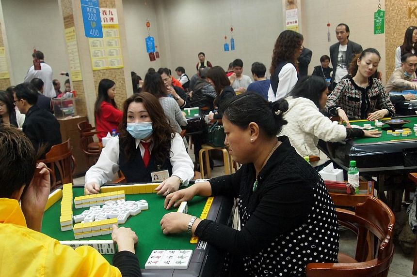 Kai Kee Mahjong packed on a Monday evening. The space with about 20 tables draws around HK$100,000 (S$16,000) in commissions a month. The number of licensed mahjong parlours in Hong Kong has fallen from 144 in 1956 to just 66 today. Young people seem