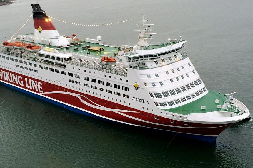 This handout photo released by the Finnish Border Guard shows Viking Line cruise ship Amorella ground outside Mariehamn, Aland on Dec 14, 2013. A ferry carrying 1,945 passengers from Finland to Sweden ran aground on Saturday after its steering system