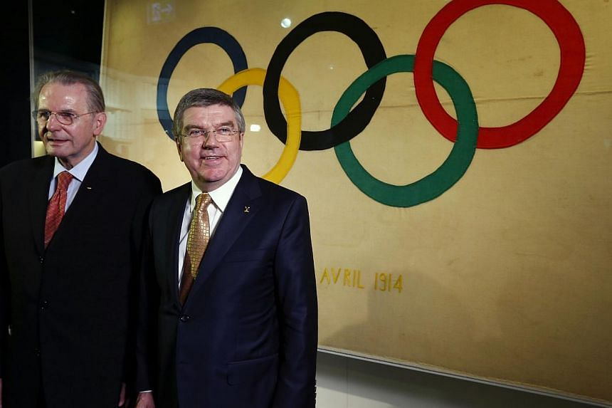 International Olympic Committee (IOC) President Thomas Bach (right) poses with his predecessor Jacques Rogge in a new presentation room at the Olympic Museum in Lausanne on Dec 10, 2013. The International Olympic Committee (IOC) has set up a US$10 mi