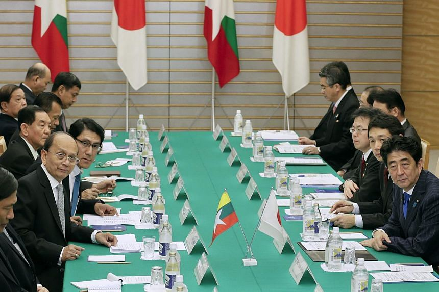 Myanmar's President Thein Sein (third from left) and Japan's Prime Minister Shinzo Abe (right) talk at the prime minister's official residence in Tokyo Dec 15, 2013. Japan and Southeast Asian countries on Sunday pledged to boost economic and security