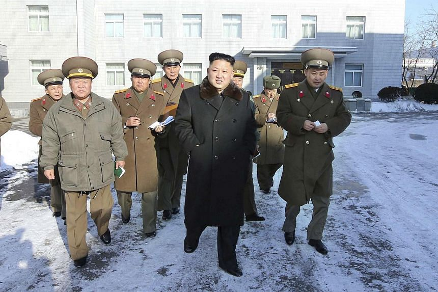 North Korean leader Kim Jong Un (centre) visits the Designing Institute of the Korean People's Army, in this undated photo released by North Korea's Korean Central News Agency (KCNA) in Pyongyang on Dec 14, 2013. Mr Kim visited a ski resort under con