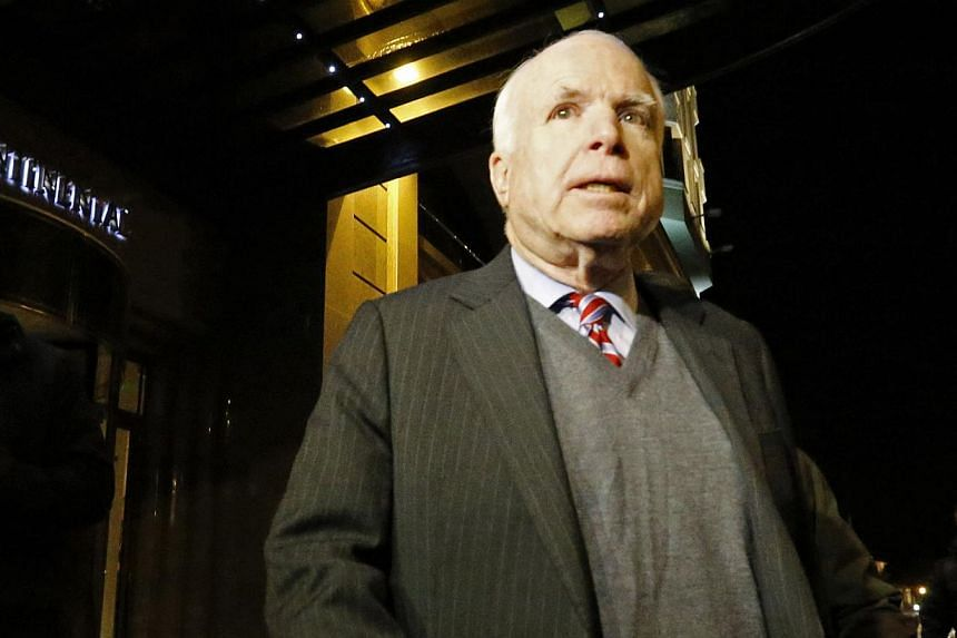US Senator John McCain exiting a hotel after meeting with Ukrainian opposition leaders including former heavyweight boxing champion Vitali Klitschko, in Kiev on Dec 14, 2013. -- FILE PHOTO: REUTERS