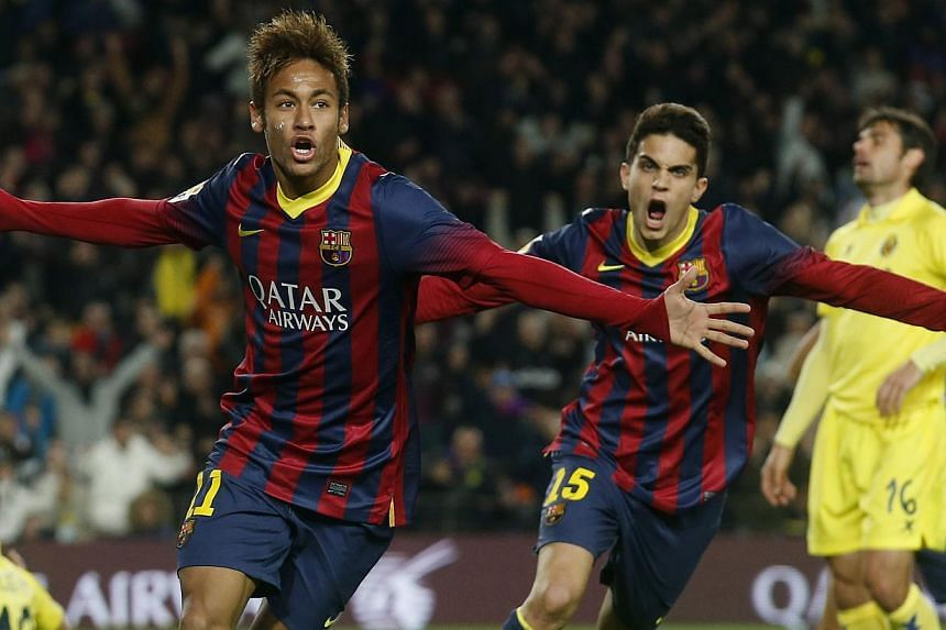 Barcelona's soccer player Neymar (left) and Marc Bartra celebrate a goal against Villarreal during their Spanish First division League soccer match at Camp Nou stadium in Barcelona on Dec 14, 2013. Barcelona moved five points ahead of Real Madrid at