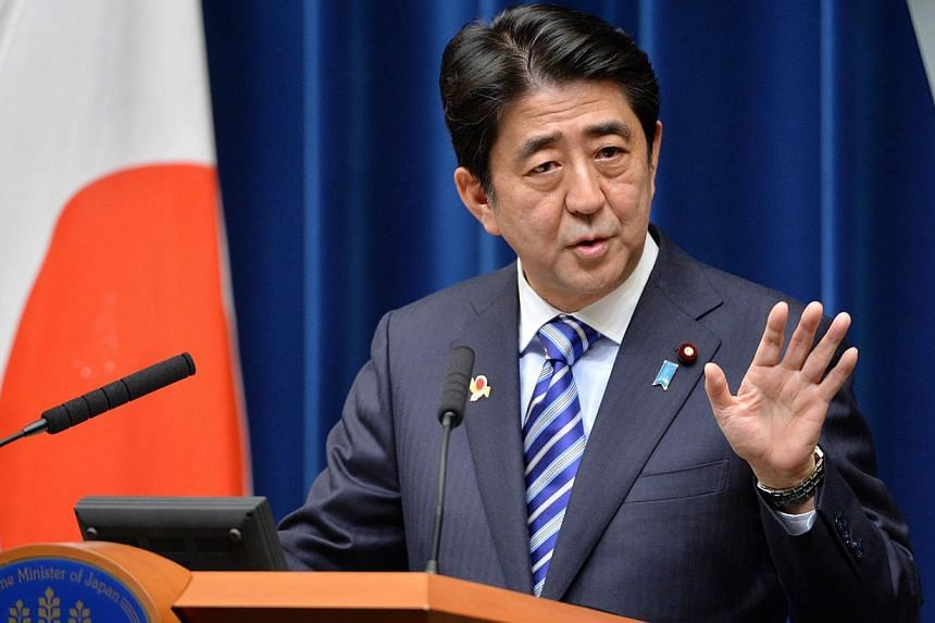 """Japanese Prime Minister Shinzo Abe delivers a speech during a press conference at the Abe's official residence Tokyo on Dec 14, 2013. China has condemned Mr Abe for """"maliciously slandering"""" its air defence zone in an escalating war of words between t"""