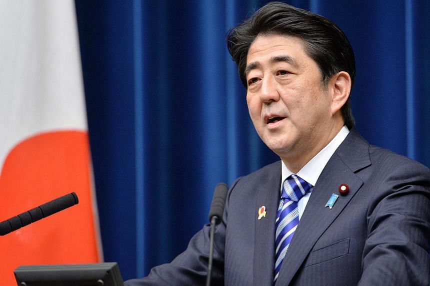 """Japanese Prime Minister Shinzo Abe delivers a speech during a press conference at the Abe's official residence Tokyo on Dec 14, 2013. Japanese Prime Minister Shinzo Abe said it was a """"great honour"""" to be a joint winner of The Straits Times' Asian of"""