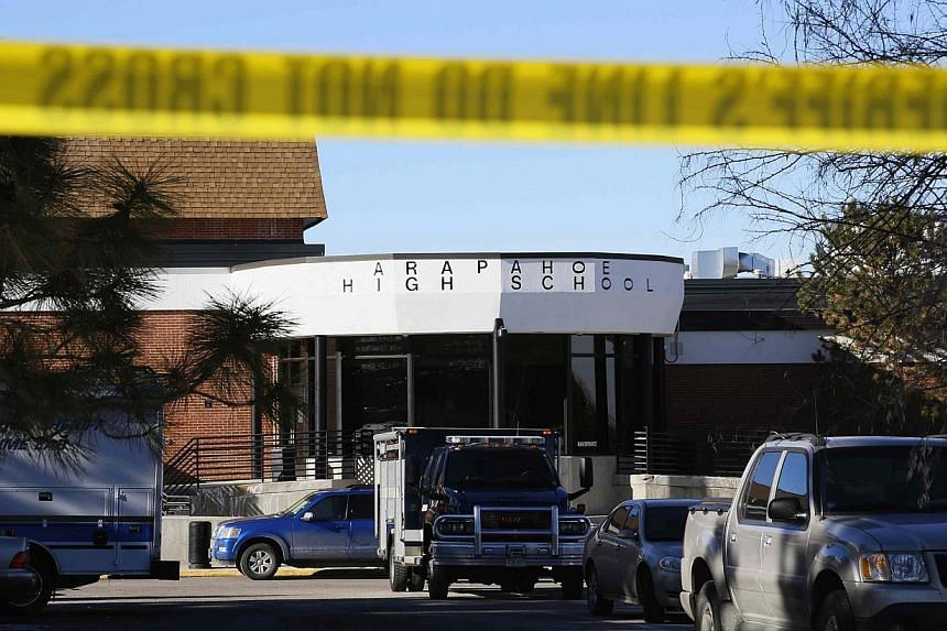 Police barricade tape surrounds Arapahoe High School after a shooting incident in Centennial, Colorado on Dec 14, 2013. The teenage gunman who shot two Colorado students was armed with many rounds of ammunition, a machete and three Molotov cocktails