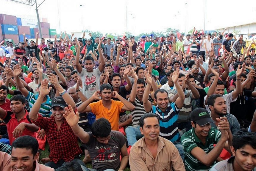 More than 50,000 foreign workers attended celebrations across the island on Sunday to mark International Migrants Day, which is on Wednesday. -- PHOTO: NTUC