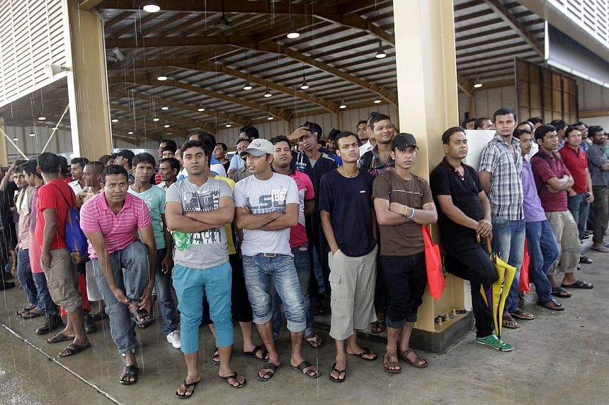 More than 50,000 foreign workers attended celebrations across the island on Sunday to mark International Migrants Day, which is on Wednesday. -- ST PHOTO:CHEW SENG KIM