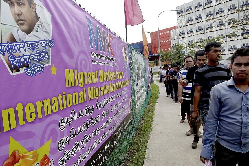 More than 50,000 foreign workers attended celebrations across the island on Sunday to mark International Migrants Day, which is on Wednesday. -- ST PHOTO: CHEW SENG KIM