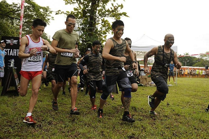 Over 6,000 participants took part in the inaugural Commando Challenge on Sunday, an urban race where runners had to go through obstacles over a 4km or 12km route. -- PHOTO:COMMANDO CHALLENGE