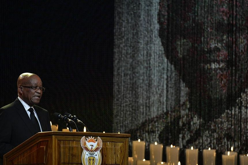 South African President Jacob Zuma on Sunday told a country mourning for its founding father Nelson Mandela that it was incumbent on them to carry on his legacy. -- PHOTO: AFP