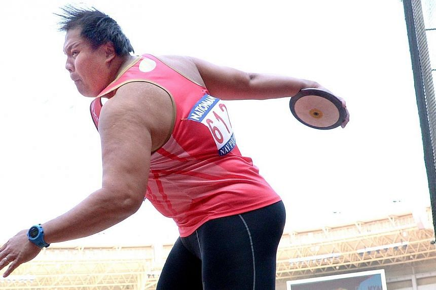 James Wong in the discus event. He failed to win a medal. First day of athletics competition at the 27th SEA Games in Naypyitaw, Myanmar, on Saturday, Dec 14, 2013. -- ST PHOTO: LIM SIN THAI