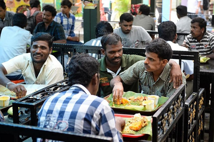 Men of south Asian descent have lunch at little India arcade on the 2nd day of the alcohol ban, in the area, on Sunday, Dec 15, 2013.A greater police presence, stricter enforcement as well as less alcohol and congestion are some of the measures