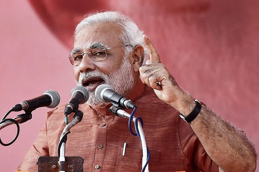 """India's opposition candidate for premier Narendra Modi predicted on Sunday that voters would soon """"root out the corrupt"""" ruling Congress party nationwide, after state poll victories for his party this month. -- FILE PHOTO:REUTERS"""