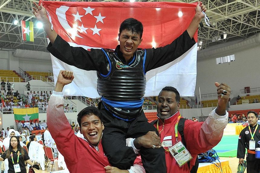 Singapore's SEA Games silat campaign ended on a high on Sunday, with Muhammad Nur Alfian Juma'en (top) clinching gold in the men's Class F (70-75kg) category. -- PHOTO: SINGAPORE SPORTS COUNCIL