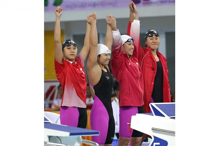Singapore's quartet of (from left) Samantha Yeo, Tao Li, Amanda Lim and Quah Ting Wen are introduced before the start of the women's 4x100m medley relay in swimming competition of the 27th SEA Games in Naypyidaw's Wunna Theikdi Swimming Com