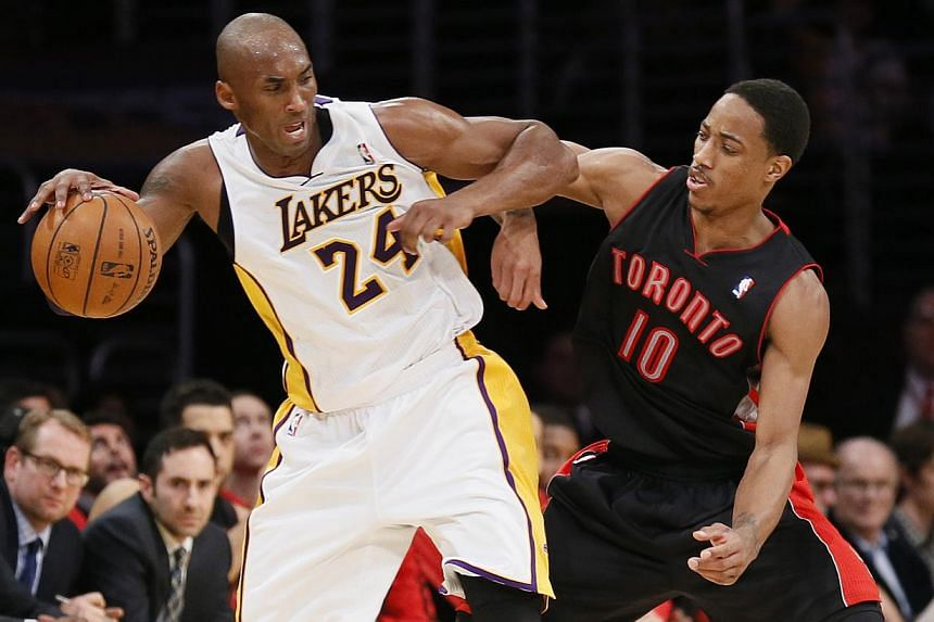 Los Angeles Lakers' Kobe Bryant (left) dribbles the ball as he is defended by Toronto Raptors' DeMar DeRozan, right, during the second half of an NBA basketball game in Los Angeles on Sunday, Dec 8, 2013. Like a jigsaw puzzle where a new piece has be