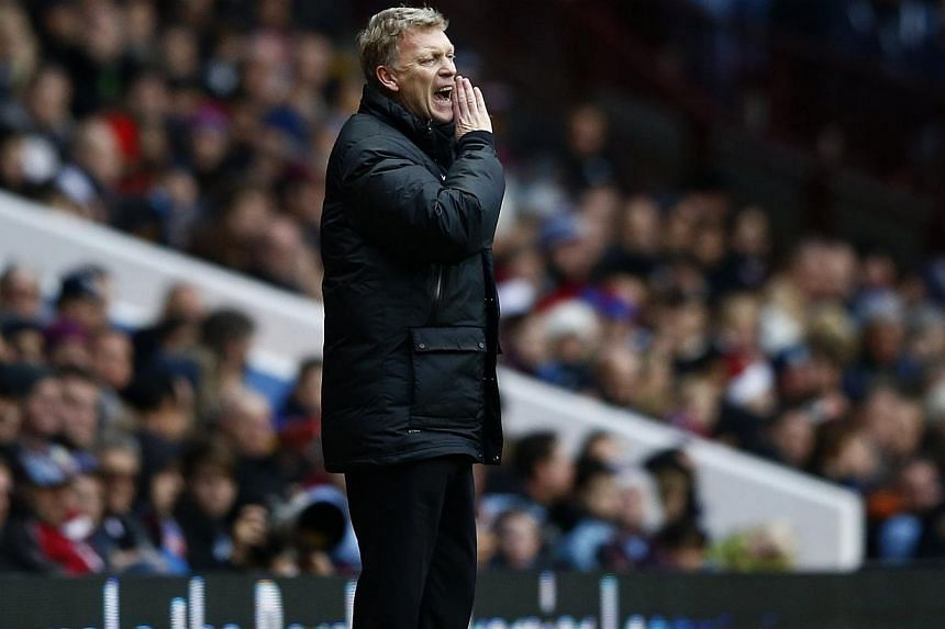 Manchester United manager David Moyes instructing his team during their English Premier League match against Aston Villa at Villa Park in Birmingham. Moyes has called for referees to offer better protection to winger Adnan Januzaj despite seeing his