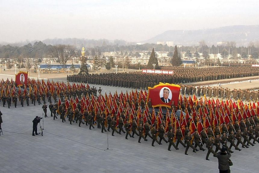 North Korean People's Army soldiers take part in a rally to swear allegiance to North Korean leader Kim Jong Un ahead of the second death anniversary of former leader Kim Jong Il at the Kumsusan Palace of the Sun, in this undated photo released by No