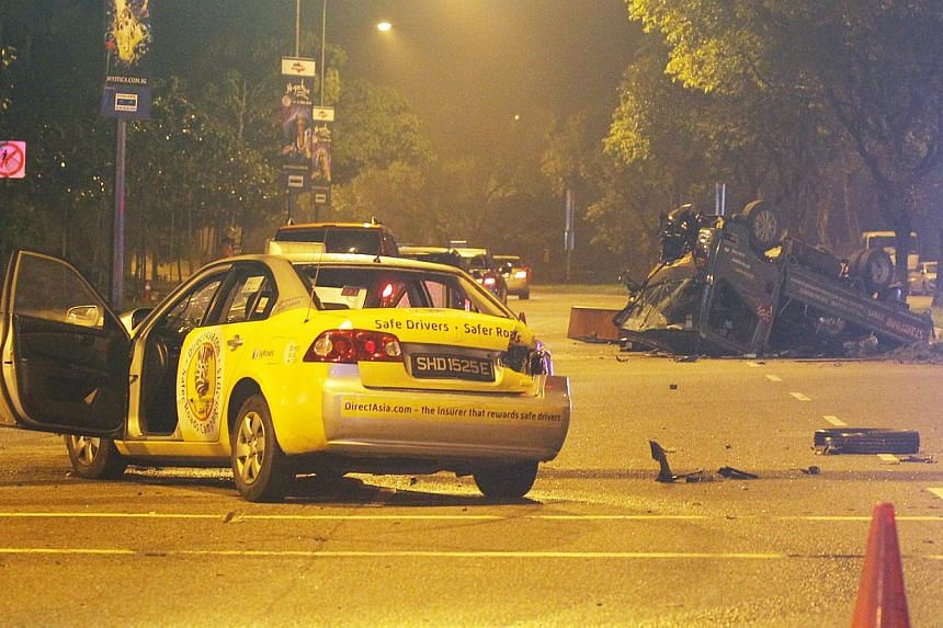 Chinese evening daily Lianhe Wanbao said the impact of the crash (above) caused the lorry to spin around before flipping over onto its back, while the taxi had its front smashed and its windshield shattered. Mangled vehicle parts (left) were strewn a