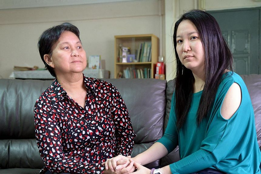 Madam Sim, seen here with her daughter Rachel, was moved to a different plan after her old one was discontinued. The new plan covered only 70 per cent of the cost of her dialysis treatments at a private centre.