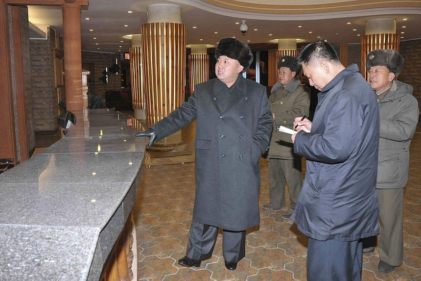 North Korean leader Kim Jong Un (left) visiting the Masik-Ryong Ski Resort, his pet project near Wonsan, in this photo released by North Korea's Korean Central News Agency in Pyongyang on Dec 15, 2013. Mr Kim spent a whirlwind weekend making public a