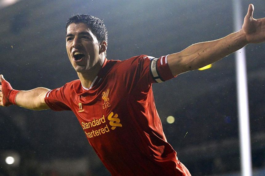 Liverpool's Luis Suarez celebrates after scoring a goal during their English Premier League soccer match against Tottenham Hotspur at White Hart Lane in London on Dec 15, 2013. Suarez scored twice as Liverpool moved back into second place in the Prem