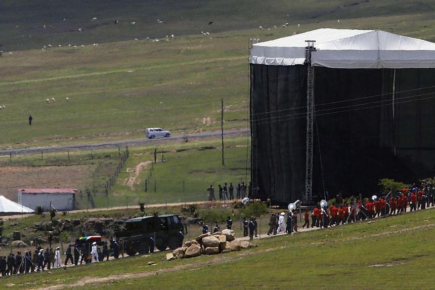 Former South African President Nelson Mandela's coffin arrives at the family gravesite for burial at his ancestral village of Qunu in the Eastern Cape province, 900 km south of Johannesburg on Decr 15, 2013. Will the gravesite of Nelson Mandela, one