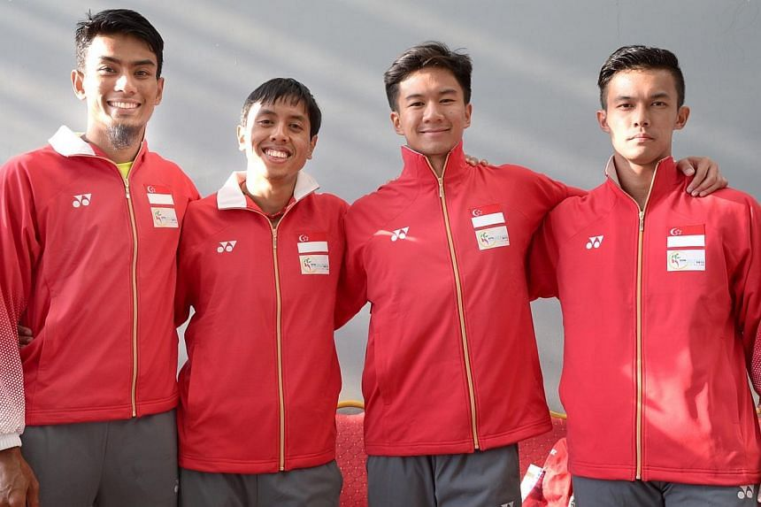 Singapore's 4X100m relay team (from left) Muhammad Elfi Bin Mustapha, Muhammad Amirudin Bin Jamal, Calvin Kang and Lee Cheng Wei.Singapore's 4x100m relay sprint team clinched a silver medal at SEA Games in Naypyidaw on Monday, Dec 16, 2013.&nbs