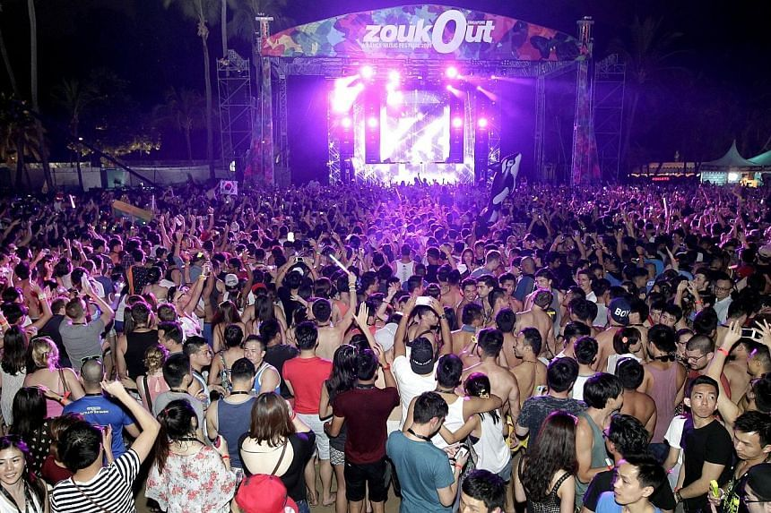 Party-goers may have thronged the two-day annual dance music festival ZoukOut at Sentosa's Siloso Beach last weekend, but four men will be facing the music of a different kind.-- ST PHOTO:CHEW SENG KIM