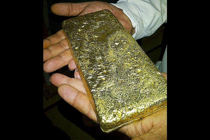 A gold bar produced by CNMC Goldmine facility in Kelantan, Malaysia. --CNMC GOLDMINE