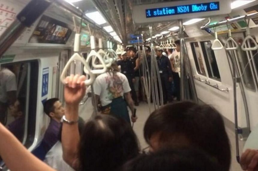 A man decked in a samurai outfit and wielding a samurai sword was eventually apprehended at 12.45pm at Jalan Pisang, near Bugis MRT station after a foot chase. -- PHOTO: TWITTER USER @SWIRLSOF