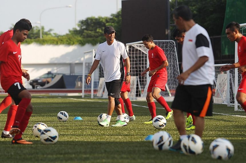 New LionsXII coach Fandi Ahmad's first training session as the new coach of LionsXII, on Dec 16, 2013. Fandi has gone for a blend of youth and experience to defend the Malaysian Super League (MSL) title. -- ST PHOTO: ONG WEE JIN