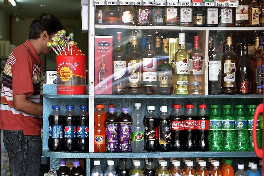The ban on the consumption of alcohol in public places in Little India will continue, Second Minister for Home Affairs and Trade and Industry S Iswaran announced on Tuesday night, during a visit to a foreign workers' dormitory in Jurong. -- FILE PHOT