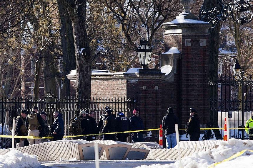 State and local police respond to reports of explosives at Harvard University in Cambridge, Massachusetts on Dec 16, 2013. Harvard University on Monday reopened four buildings at the heart of its centuries-old campus in Cambridge, Massachusetts, that
