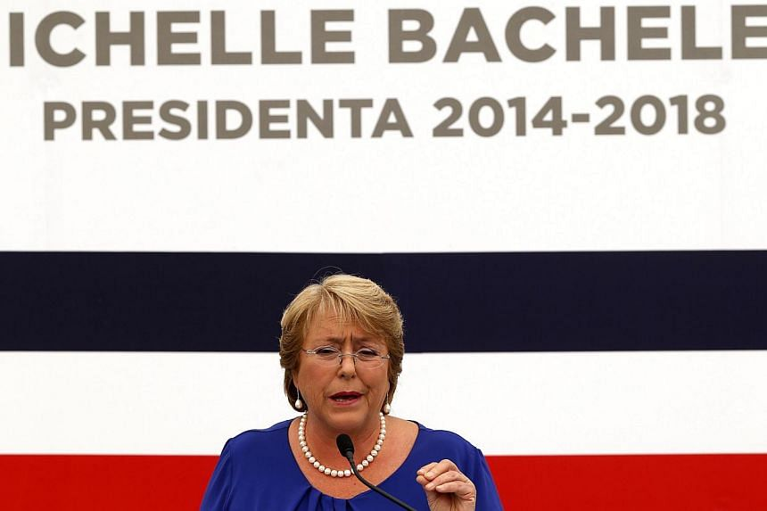 Chile's President-elect Michelle Bachelet answering a question during a news conference at her headquarters in Santiago, on Dec 16, 2013. Ms Bachelet set the stage for the formation of her Cabinet on Monday, a day after sweeping back to power wi